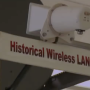 Historical Wireless Lan sign hanging from wall