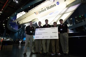 The WALRUS team, from left: Brian Eccles, Brendan McLeod, T.J. Watson, Tim Murcko, and Mitchell Wills. In the background is the Atlantis shuttle.