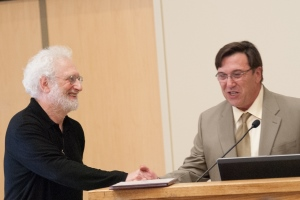 Roger Gottlieb, left, accepts his award from Jose Arguello, recipient of the 2012 award for outstanding research.