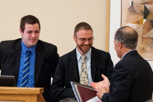 Destin Heilman, center, accepts his award from Dominick Calvao '15, left, and Stephen Rubin '74, chair of the WPI Board of Trustees.