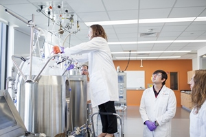 Participants prepare a single-use bioreactor at WPI's Biomanufacturing Education and Training Center.