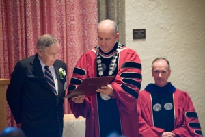 President Berkey presents a citation to Paul Beswick during the installation of Professor Hoy (seated) as the Beswick Professor.