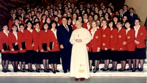 In Rome, Curran and members of the Glee Club (in background) had an audience with Pope John Paul II.