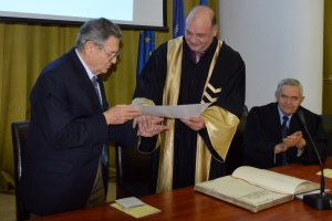Emanuel receives his honorary degree from Polytechnic University of Bucharest rector George Darie