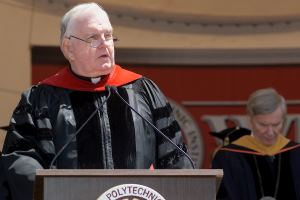 Scanlon delivers the benediction at Commencement in 2003.