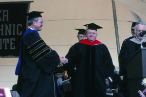 President Jon Strauss presents Grogan with an honorary doctor of engineering degree in 1990.