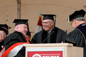 Grogan receives the Presidential Medal in 2005 from F. William Marshall Jr., then chair of the Board of Trustees, during the inauguration of President Berkey.