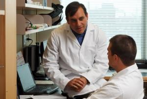 Luis Vidali, left, with a student in his lab.