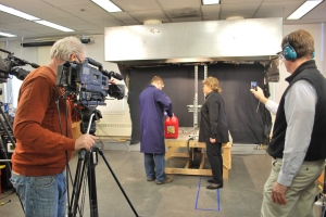 A cameraman and NBC producer Rich Gardella, far right, record as Brian Elias shows correspondent Lisa Myers how the gas can tests were conducted.