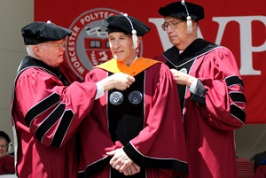 Honorary degree recipient Stephen Rubin '74 is hooded by Interim President Ryan and Board Chairman Warner Fletcher