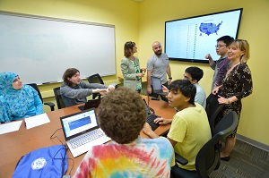 Elke Rundensteiner (far right) works with students on an economic policy data tool for Massachusetts