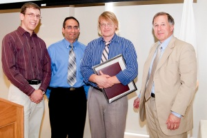 From left, Skyler Whorton '11. Stephen Bitar, 2009 Teacher of the Year, Makarov, and WPI Board Chairman Stephen Rubin '74