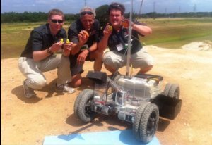 With the Team Oryx rover are, from left, Andrew Cunningham '13, Ken Stafford, and Jon Anderson '12.