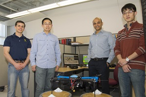 Professor Cowlagi (second from right) with graduate students Benjamin Cooper, Zetian Zhang, and Ruixiang Du