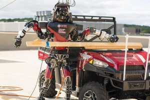 WPI's WARNER robot practices getting into a vehicle in preparation for the DARPA Robotics Challenge.