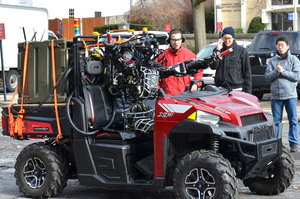 WARNER, a robot trained by WPI's Team WRECS, tests his driving skills on campus recently.