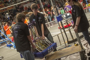 Team members with their robot at the 2013 WPI FIRST Regional Competition in March.