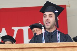 Joshua Croke '14 leads the singing of the Alma Mater