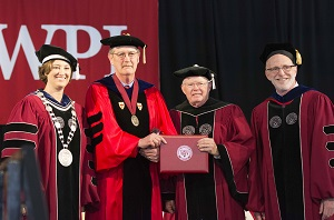 Laurie A. Leshin, Wesley T. Mott, Philip Ryan, and Provost Bruce Bursten