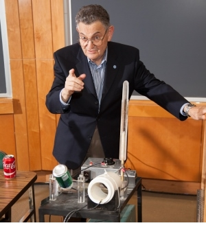 At a recent ECE Department 'Spark Party,' Emanuel demonstrated a student-designed device that uses a laser capacitor to crush cans and launch them 30 yards