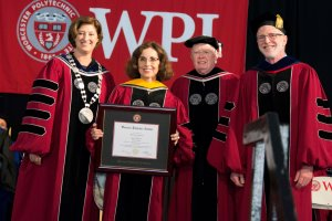 Córdova with, from left, President Leshin, Chairman Ryan, and Provost Bruce Bursten, received an honorary doctor of science degree.