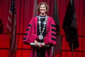 Following her investiture, President Leshin holds the WPI charter and wears a medalion with the WPI seal