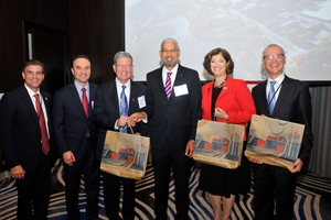 Pictured from left to right:  Nicolas Corcione '91, Fernando Motta '83, Joseph Adams '75, ACP's Manuel Benitez, WPI President Laurie Leshin, and WPI Professor Tahar El-Korchi.