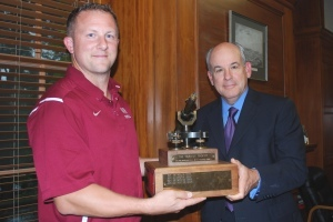 President Berkey, right, and Coach Robertson with the trophy