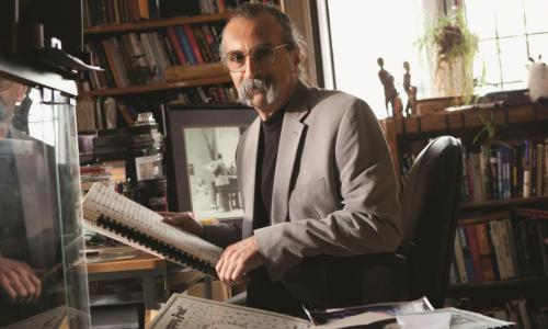 Rich Falco sits in his office in Alden Memorial surrounded by jazz memoriabilia