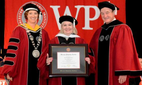 Deborah Wince-Smith, center, receives an honorary doctorate from WPI President Laurie Leshin, left, and WPI Board Chairman Jack Mollen alt