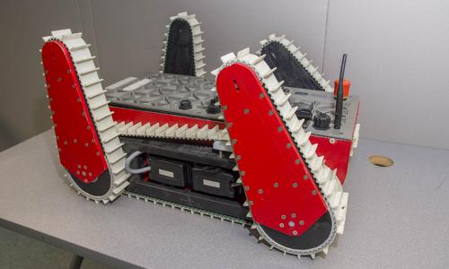 A photo of the gray, black, and red WALRUS bot.