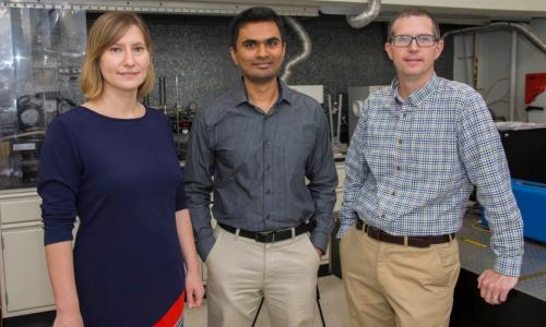 From left, From left, Lyubov Titova, Pratap Rao, and Aaron Deskins, stand in the WPI NanoEnergy Lab looking toward the viewer alt