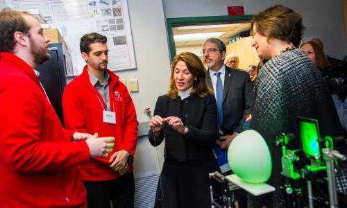 Lt. Gov. Karyn Polito, center, tours a photonics lab at WPI alt