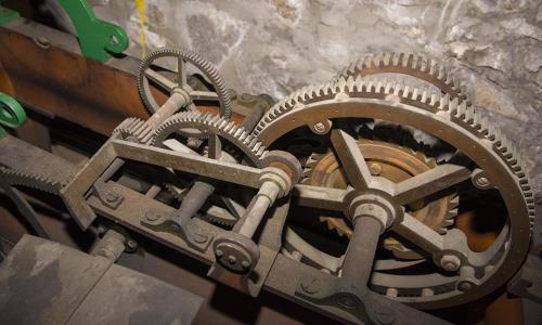 A close-up photo of some of the gears located in the Boynton Clock Tower.