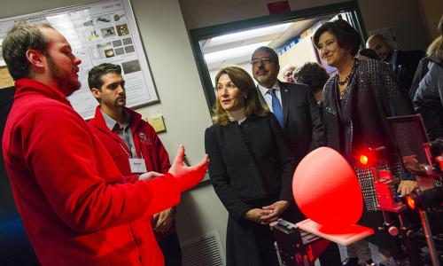 WPI researchers explain their latest technology to Karyn Polito and other guests while Laurie Leshin looks on. alt