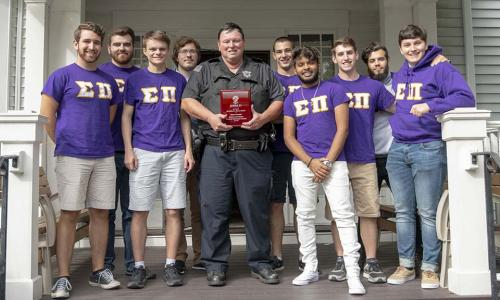 WPI police officer with fraternity brothers