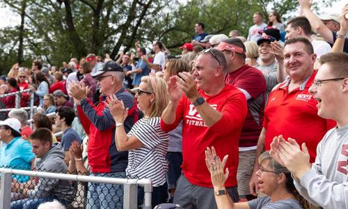 Crowds of family members fill the bleachers of Alumni Stadium during the Family Weekend football game.