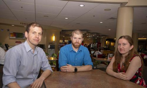 L-R: Daniel Suitor, Christopher Renfro, Maggie Gaffney in the food court at the Rubin Campus Center. alt