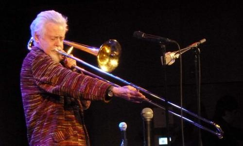 Roswell Rudd performs onstage. alt