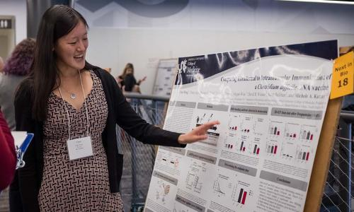 A Next-in-Bio participant presents her poster to attendees.