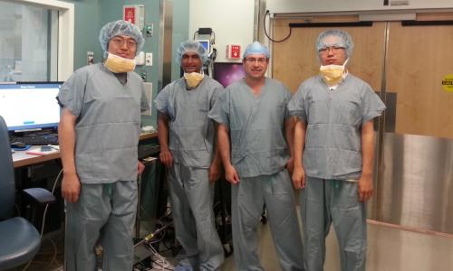 Gregory Fischer, second from right, with PhD candidates, from left, Weijian Shang, Nirav Patel, and Gang Li, at Brigham and Woman's Hospital, where a surgical robotic system he developed for prostate biopsies was involved in a clinical trial alt