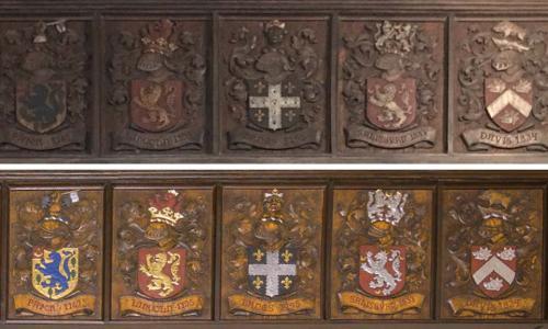 Higgins wood carving restored alongside older version