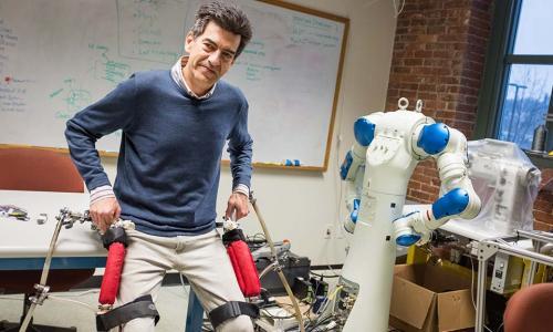 WPI researcher with exoskeleton alt