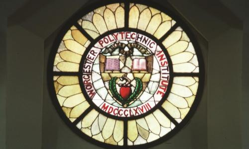 Photo of the stained-glass WPI seal window in the chapel of Boynton Hall