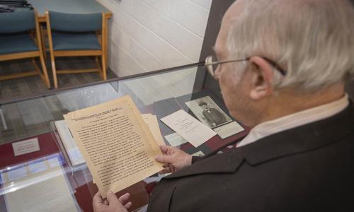 WPi history professor reading FDR speech alt