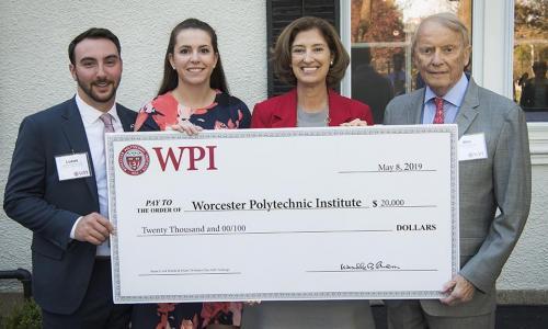 WPI trustee presenting check alt