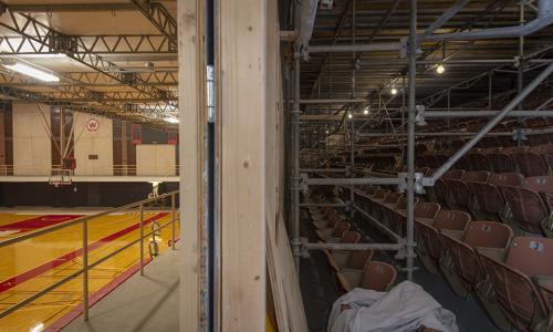 Harrington Auditorium work with scaffolding set up on the right and basketball court on the left.