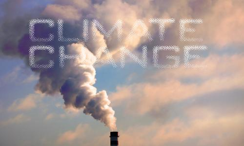 Climate change banner with power plant smokestack in background