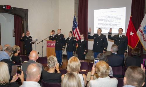 Cadets taking the oath, with retired Gen. Paul G. Smith at left. alt