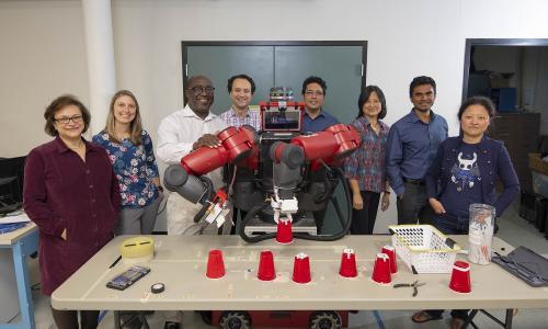 WPI researchers (from left) Soussan Djamasbi, Jeanine Skorinko, Winston Soboyejo, Cagdas Onal (principal investigator), Yunus Telliel, Jing Xiao, Pratap Rao and Jane Li with the Baxter research robot. alt